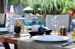 33430310 - close up of table place settings at outdoor poolside asian restaurant